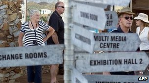 Tourists look at signs at the Nelson Mandela Museum, in the village of Qunu, where the former South African president grew up and has returned for his retirement