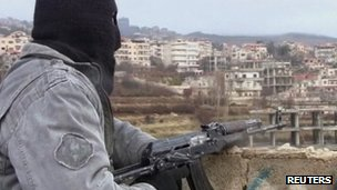 Purported photo of member of the Free Syrian Army on guard in the town of Zabadani (16 January 2012)