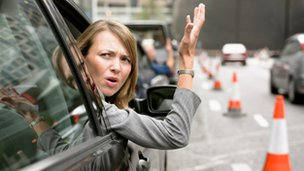 Frustrated woman in car, file pic