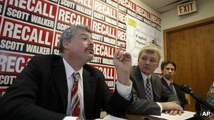Supporters of the Wisconsin recall petition speak to reporters in Madison, Wisconsin 17 January 2012. 