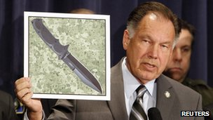 Orange County District Attorney Tony Rackauckas shows a picture of a knife similar to the one the murderer used, at a news conference in Santa Ana, California, on 17 January 2012