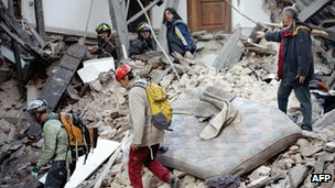 Rescuers search April 6 for trapped people under the ruins of a collapsed house in the centre of the Abruzzo capital L'Aquila, in April 2009