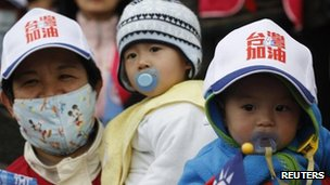Baby wears a cap during a campaign of Taiwan President and Nationalist Party presidential candidate Ma Ying-jeou in Kaoshiung on 13 January 2012