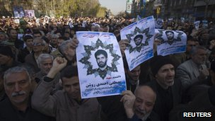 Worshippers carry portraits of Iranian nuclear scientist Ahmadi-Roshan, who was killed in bomb blast on January 11, during his funeral after Friday prayers in Tehran (13 Jan 2012)