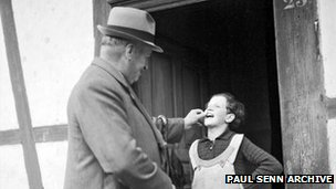 The 'poverty inspector' examines a contract girl's teeth (Paul Senn Archive, Bern)