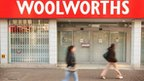 Shoppers walk past a closed branch of Woolworths on December 30, 2008 in Croydon, England