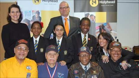 Students and teachers from Holyhead School in Handsworth with the visiting Tuskegee Airmen