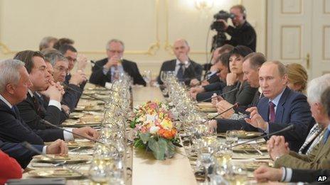 Mr Putin (gesturing) met editors of leading newspapers and broadcasters