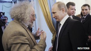 Russian journalist Alexei Venediktov (left) talks to Russian Prime Minister Vladimir Putin at a media awards ceremony in Moscow, 13 January 