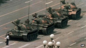 A Chinese man blocks a line of tanks heading east on Beijing's Changan Boulevard after Chinese forces crushed a pro democracy demonstration in Tiananmen Square on 5 June 1989