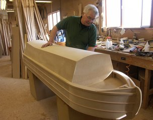 George Spencer of Crazy Coffins works on a boat-shaped casket