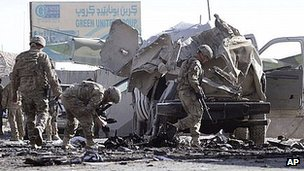 Nato troops inspect damage after Kandahar attack. 18 Jan 2012