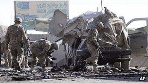 Nato troops inspect damage after Kandahar attack. 18 Jan 2012