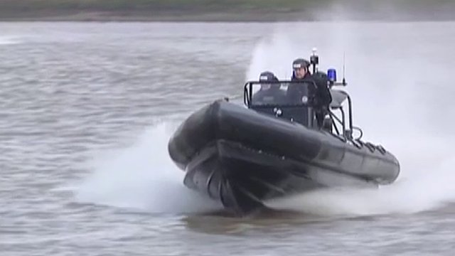Police in action on River Thames