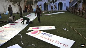 Workers put up the posters at the Jaipur Literature Festival, in Jaipur, in the Western Indian state of Rajasthan, Thursday, Jan. 19, 2012
