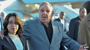 Cuban President Raul Castro (R) gestures at Jose Marti airport, on January 12, 2012