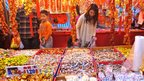 A woman inspects sweets at a market ahead of the Lunar New Year holiday in Taipei, 19 January 2012