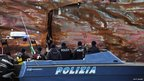Police inspect one of the holes in the side of the ship (January 17, 2012)