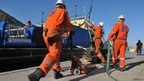 Rotterdam-based SMIT salvage workers prepare their work of diesel recovery from the the cruise ship Costa Concordia (18 Jan 2012)