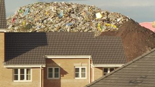 House with rubbish behind it (pictured in January)