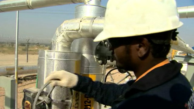 Man working at an oil processing plant