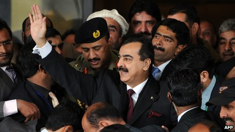 Pakistan's Prime Minister Yousuf Raza Gilani leaving the supreme court