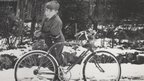 Stephen Hawking as a child with a bike in the snow (Lucy Hawking)