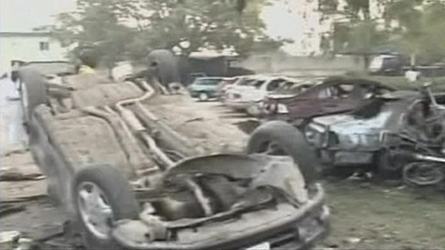 Burnt and overturned cars which were hit by a bomb attack
