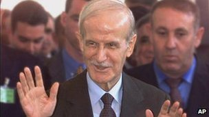 Syrian President Hafez Assad gestures upon his arrival at the Arabian Institute in Paris in this Friday, July 17, 1998, file photo