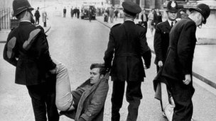 A young Peter Hain being dragged away by police at a protest