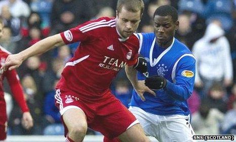 Aberdeen's Kari Arnason and Rangers Maurice Edu