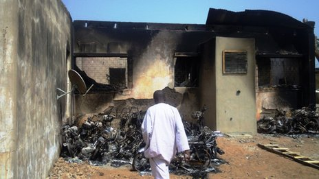 A man inspects the burnt-out wreckage of motorcycles destroyed by multiple explosions and armed assailants in the Marhaba area of the northern Nigerian city of Kano, on January 21, 2012