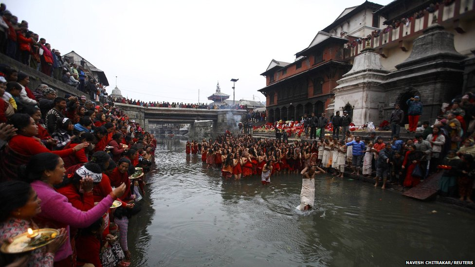 Devotees take a holy bath at the Bagmati River at Pashupatinath Temple 