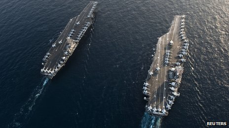 Handout photo of US aircraft carriers USS John C Stennis (left) and USS Abraham Lincoln in the Arabian Sea on 19 January 2012
