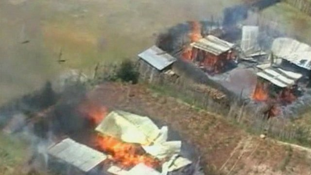 Homes on fire in Kenya in 2007