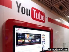People visit the 'You Tube' stand on October 3, 2011 in Cannes, southern France