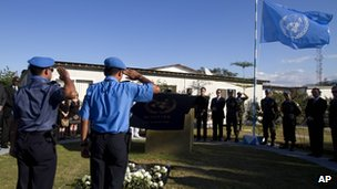 UN peacekeepers salute during a memorial service for people who died in the 2010 earthquake at the UN base in Port-au-Prince, Haiti, on 12 January 2012