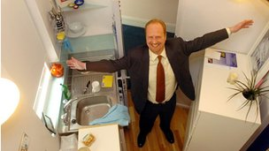 Estate agent Gordon Blausten showing the former storage cupboard which was being let in London for £135 a week, on Tuesday 24 May 2005. Measuring just 62sq ft, the converted cupboard could well have been the smallest flat in the capital