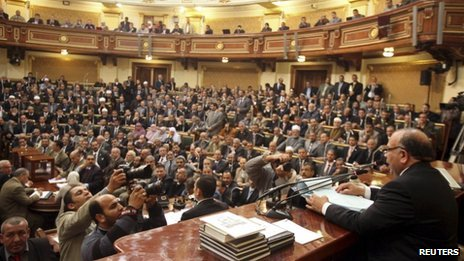 Mohammed Saad al-Katatni of the Muslim Brotherhood's Freedom and Justice Party sits in the speaker's chair in the People's Assembly (23 January 2012)