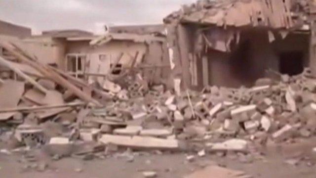 Damaged buildings in Zinjibar