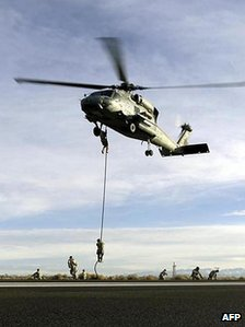 Seals practice fast roping from a SH-60B Seahawk helicopter