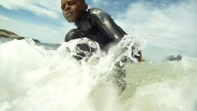 Surfing on Ipanema Beach in Brazil