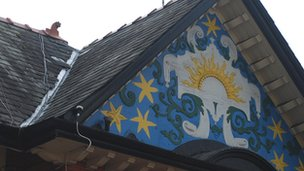 The seven stars mural on the building's gable