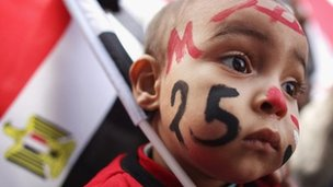 A baby wearing facepaint in Tahrir Square, Cairo (25 Jan 2012)
