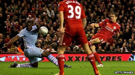 Daniel Agger's shot hits Micah Richards' arm