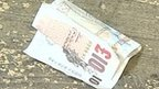 Ten pound note dropped on the floor