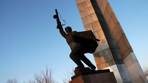 A statue of a soldier raising his gun aloft in the town of Kurchatov, Kazakhstan