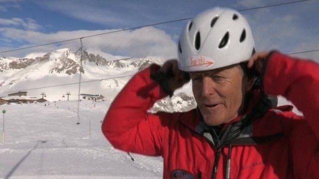Skier places helmet on