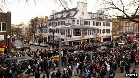 Joe Paterno's hearse passes through downtown State College, Pennsylvania on 25 January 2012
