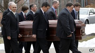 Pallbearers carry Joe Paterno's casket at  Penn State campus 25 January 2012